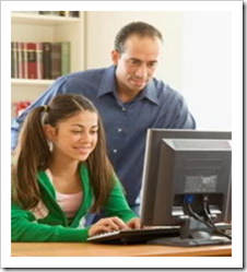Father watching daughter on computer